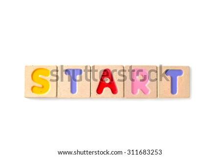 "word ""start"" written with letterpress wooden blocks on white background - stock photo"