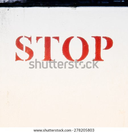 word stop painted on a wall - stock photo