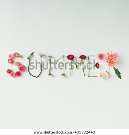 "Word ""SUMMER"" made of flowers on bright background. Spring concept. Flat lay - stock photo"