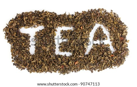 Word tea made of dry leaves isolated on white - stock photo