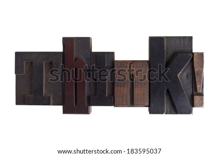 Word think in vintage wooden letterpress type, scratched and stained, isolated on white background - stock photo