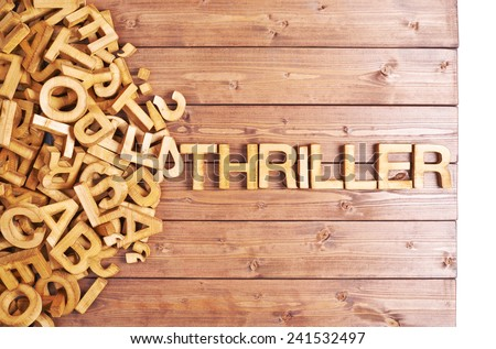 Word thriller made with block wooden letters next to a pile of other letters over the wooden board surface composition - stock photo