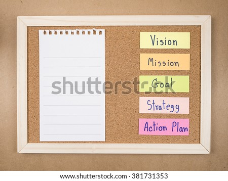 "Word ""Vision Mission Goal Strategy Action Plan"" and blank notepad on cork board (Business concept) - stock photo"