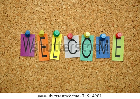 """Word """" welcome  """" placed from colourful small letters on the cork board - stock photo"""