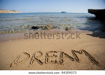 Word written in sand - stock photo