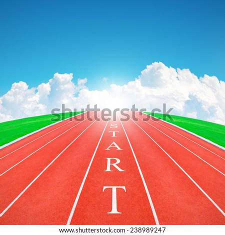 Wording START on running track in blue sky and clouds - stock photo