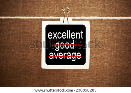 Words Average, Good and Excellent symbolizing improvement and success. Excellence concept written on a blackboard - stock photo