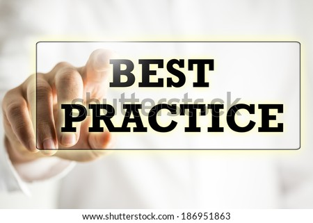 Words Best practice on a virtual interface in a navigation bar with a businessman touching it with his finger from behind. - stock photo