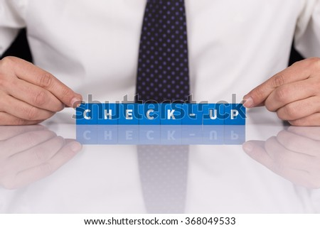 Words CHECK-UP with blocks - stock photo