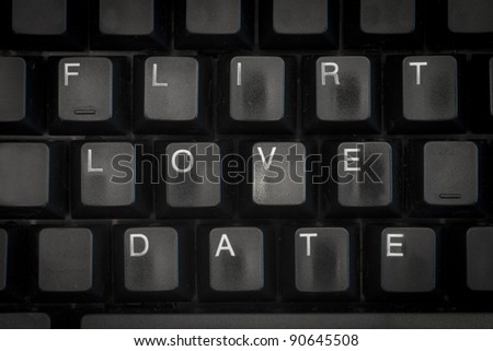 words date, love, flirt on a black computer keyboard - stock photo