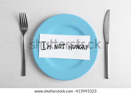 Words I'm not hungry in a plate on white table. Top view. - stock photo