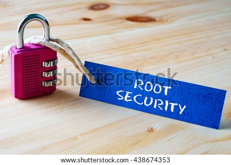 Words ROOT SECURITY written on tag label tied with a padlock. - stock photo
