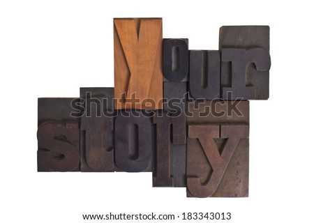 Words your story in vintage wooden letterpress type, scratched and stained, isolated on white  - stock photo