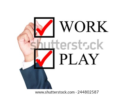 work and play together concept choose by businessman tick choice whiteboard white background - stock photo