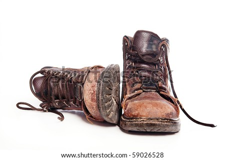 Work boots isolated against white background - stock photo