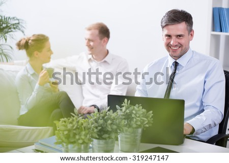 Work colleagues are talking during their coffee break - stock photo
