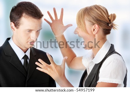 Work Colleagues arguing in office - stock photo