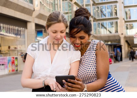 work colleagues looking at a computer - stock photo