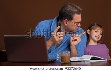 Work from home distraction - father upset with his daughter while he is on a call - stock photo