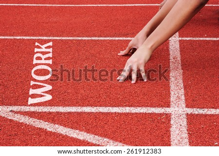 Work - hands on starting line - stock photo