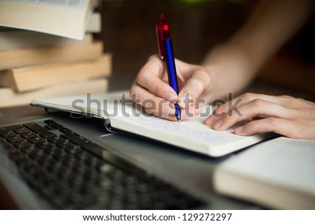 work in library or search in internet - stock photo