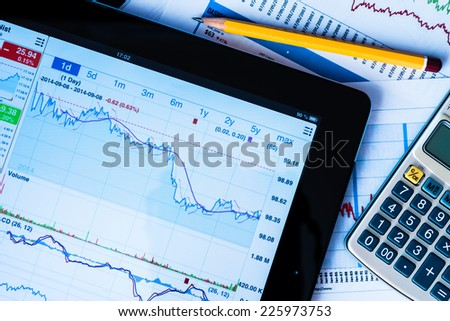 Work in stock exchange, calculate of income - stock photo