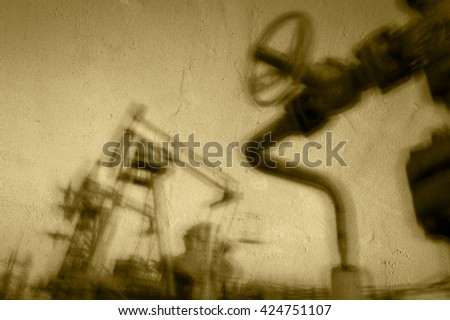 Work of oil pump jack on a oil field. Textured concrete grunge, blurred motion.  Concept oil and gas industry. - stock photo