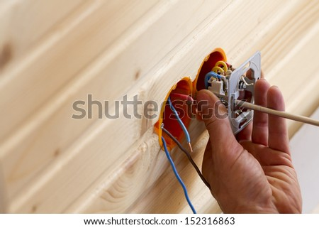 Work on installing electrical outlets. - stock photo