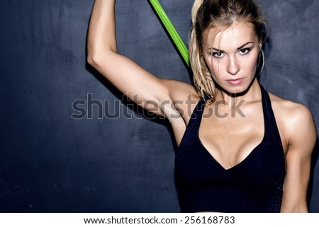 work out with rubber band, female caucasian model, trained body  - stock photo