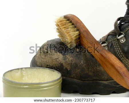 work shoes care with leather fat - stock photo
