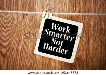 Work Smarter Not Harder Concept written on a chalkboard - stock photo