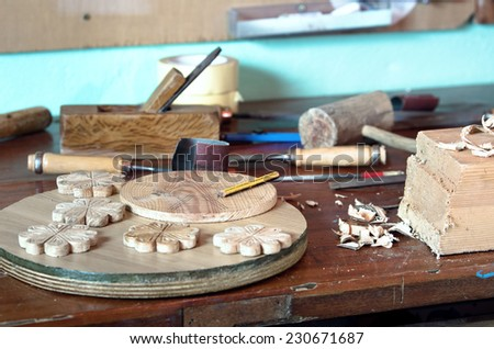 work table of a carpenter with many tools hanging in the background - stock photo