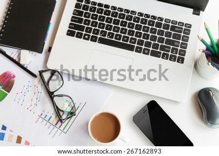work table space with laptop computer top view - stock photo