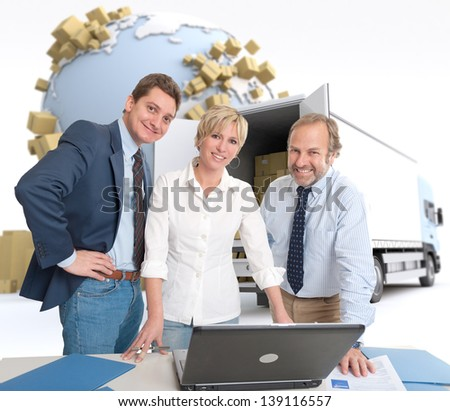 Work team around a computer in an international transportation context - stock photo