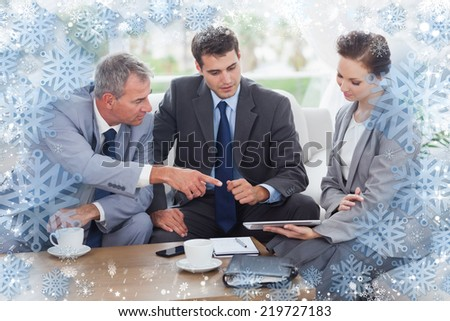 Work team having a meeting together against snow - stock photo