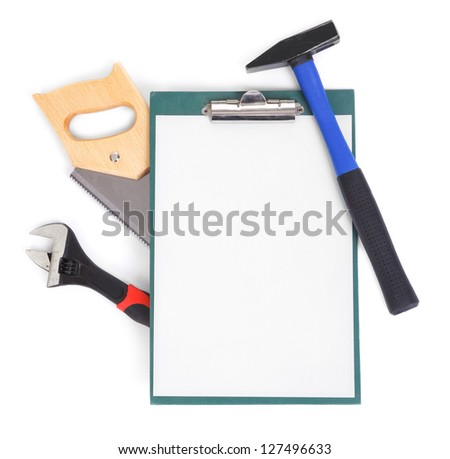 Work tools and clipboard on white, gentle natural shadow among objects - stock photo