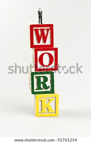 Work word and toy business man - stock photo