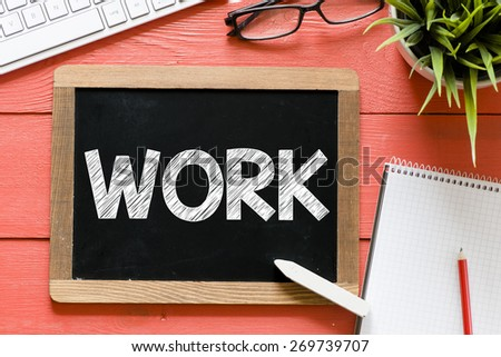 Work word Handwritten on blackboard. Work word Handwritten with chalk on blackboard, keyboard,notebook,glasses and green plant on wooden background - stock photo
