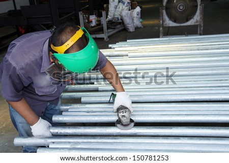 Worker are finishing steel pipe - stock photo