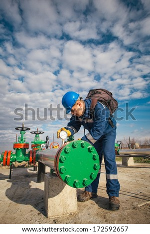 Worker at industrial plant - stock photo