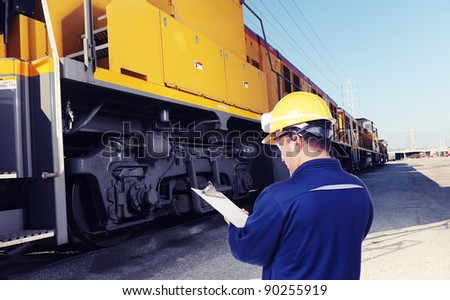 worker checking on train machine - stock photo