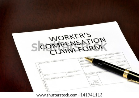 Worker compensation form for employment related injury or damage - stock photo