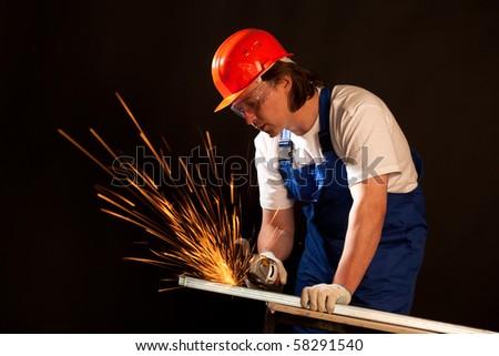 worker cutting metal - stock photo
