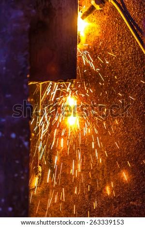 worker cutting steel board using metal torch - stock photo