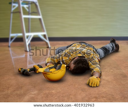 Worker falls from ladder and loses helmet. - stock photo