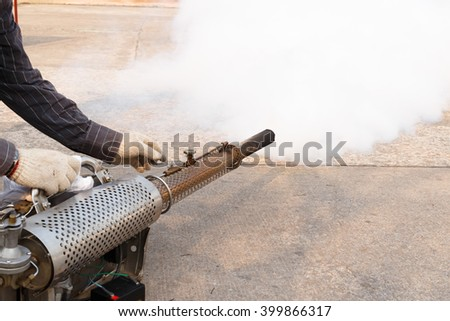 Worker fogging mosquito to prevent of dengue fever and zika virus.Fogging to kill  mosquito larva.Medical concept. - stock photo