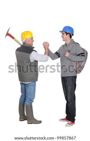 Worker greeting apprentice - stock photo