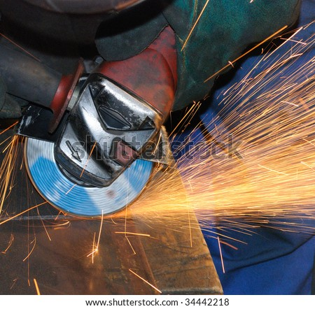 worker grinding - stock photo