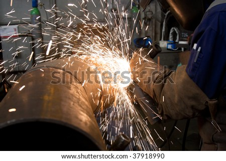 worker grinding metal and sparks - stock photo