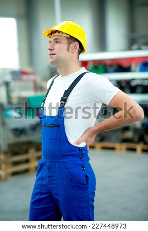 worker has back pain - stock photo